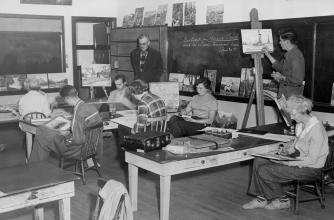 Black and white photo of painting class from the 1950's