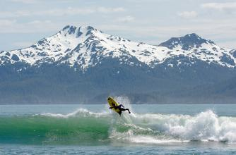 Chris Malloy catching waves off the coast of Alaska