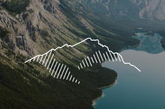 Icon of a mountain over a rocky mountain backdrop