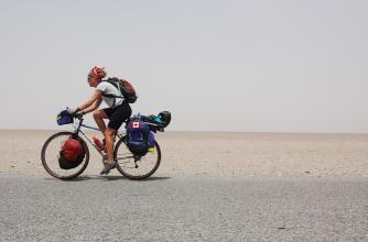 Kate Harris cycling in Tibet