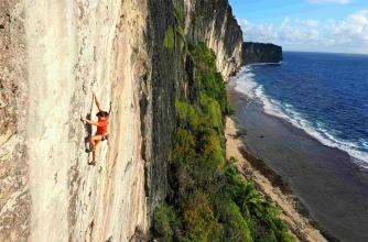 A female athlete is climbing on the coast.