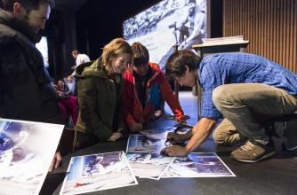 David Lama signing Posters on the Banff Mountain Festival Stage