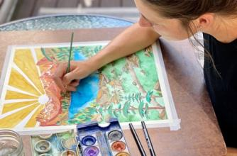 Artist Bryn Merrell creates a colorful watercolor piece with mountains and lakes.