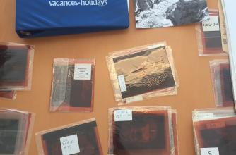 A picture of photograph negatives and other archival material from the Everest 1982 collection.