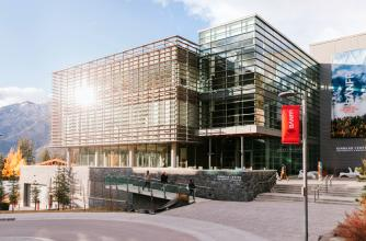 Sunny picture of Kinnear Centre on Banff Centre campus.