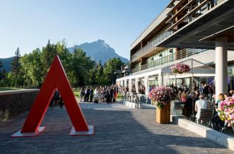 Banff Centre campus with Ball guests in the background overlooking Cascade Mountain.