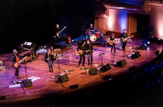 Banreny Bentall and The Cariboo Express play on stage with 8 musicians total.
