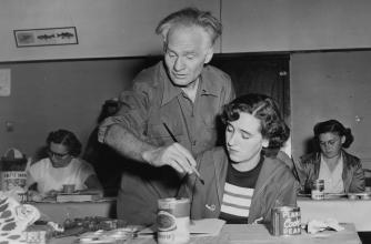 Art instructor Andre Bieler assisting a student, 1952, Banff Centre.