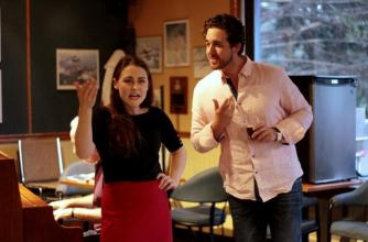 Opera singers perform in a pub setting wearing casual clothes.