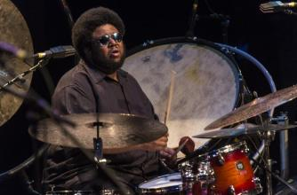 Tyshawn Sorey mid-performance on a large percussion set.