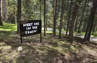 Mark Clintberg, Meet me in the woods, 2010. Coated aluminum and reflective vinyl signs in two locations: Glyde Hall and the Ken Madsen path. Commissioned for the collection of the Alberta Foundation of the Arts to celebrate the 75th anniversary of Banff C