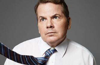 Bruce McCullloch looks up to his right as the tie he is wearing is blown that direction.