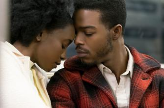 A couples sits in a subway car with their heads leaned together, if beale street could talk.