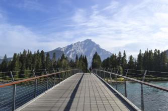 Looking from the Banff Pedestrian Bridge with Mount Rundle appearing on the Horizon
