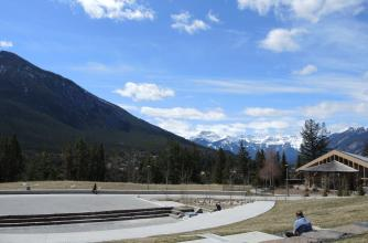 Phyllis Novak takes time to reflect looking at the Bourgeau mountain range. View from the amphitheatre at The Banff Centre