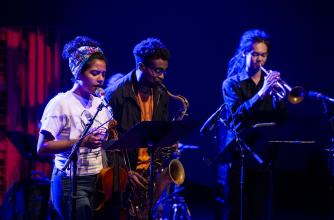 Three Musicians jam in darkened club