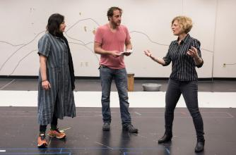 Rehearsal photo from A Thousand Splendid Suns produced by American Conservatory Theater & Theatre Calgary – director Carey Perloff (right), actor Haysam Kadri (centre), actor Kate Rigg (left), photo credit: Stefan Cohen