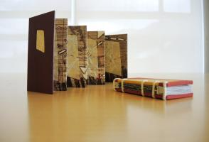 Image of two artists' books by Bonnie Stahlecker, Four Pasages and Land Marks