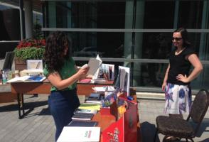 Patron reading a book at the pop-up library table