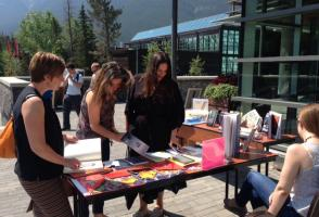 Patrons looking at books at the pop-up library
