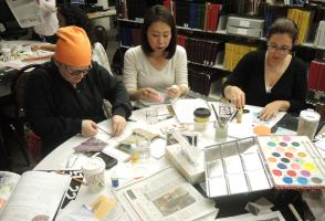 Participants work on creating their own decks