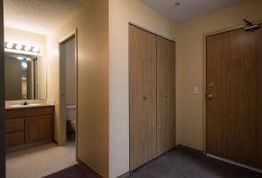 Apartment corner with kitchen and bathroom door.