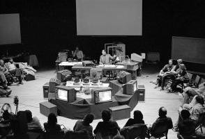 Archival photo of a workshop on stage of the Eric Harvie Theatre