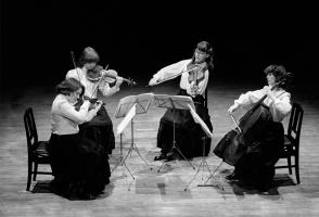 Archival photo of four women performing in a quartet.