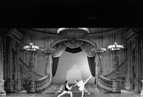 Archival photo of dancers performing on a grand stage.