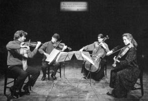 Archival photo of a mixed quartet performing on stage.