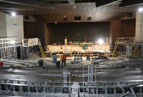 Workers re structure the layout of the theatre.