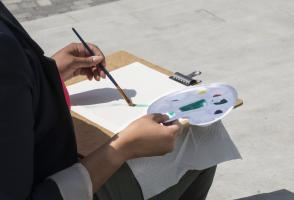 Employee painting using water colour