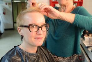Carol Chambers puts Andrea Stienwand's hair into pincurls