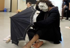 Participant in mask and Umbrella