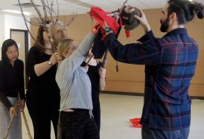 Participants rehearse with their tree and man puppets