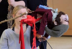 Participants rehearse the death of their puppet character