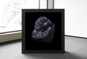 A black light box with an image of a rock sits in the corner of the room.