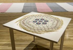 """Rebecca Baird, installation view of """"Memory Claim #1"""" (1995). Sweetgrass, hide, porcupine quills, seed beads, abalone buttons. 81cm (diameter). Collection of the Walter Phillips Gallery, The Banff Centre. Photograph by Rita Taylor."""