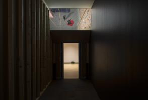 """Daniel Jacoby, installation view of """"Ahold of Get the Things To"""" (2013). 16mm film transferred to digital video, 17 minutes, architectural installation and inkjet prints. Walter Phillips Gallery, The Banff Centre. Photograph by Rita Taylor."""