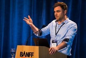 David Maggs stands at a Banff Centre lectern.